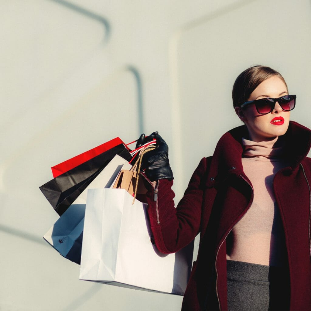 spending money - woman with shopping bags